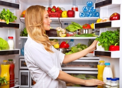 25864226 - happy female search something in the fridge, fresh fruits and vegetables in the refrigerator, cooking diet food, fit and body care concept