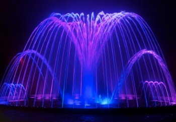 7988301 - colored water fountain at night