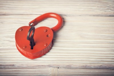 36508847 - open heart shaped lock and key over light vintage wooden background
